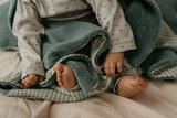 double-layer crib blanket (75x100 cm). Made in Turkey of 100% organic cotton and 100% recycled polyester. TOG 2.0 Smokey Green_